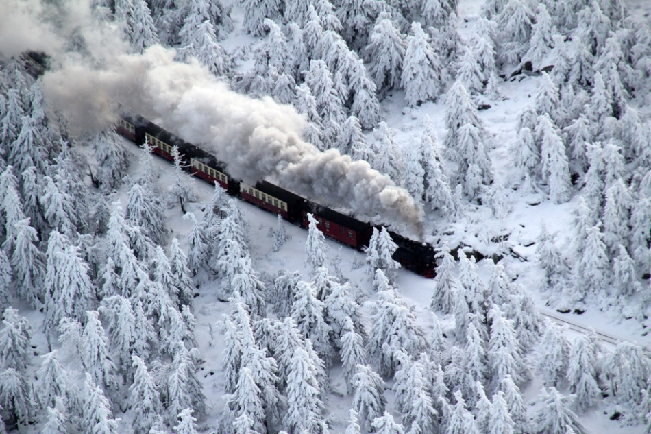 train in a winter landscape by Stefan Rampfel